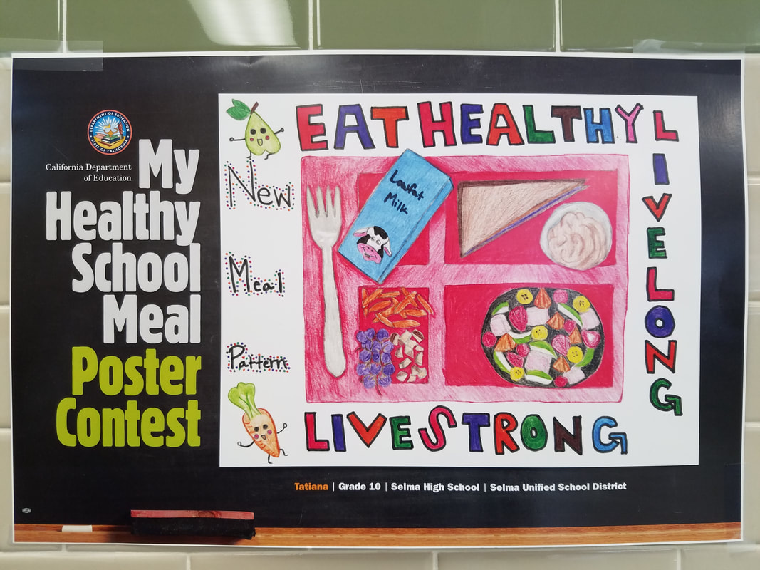 Picture of a studnet designed poster that says to Eat Healthy!